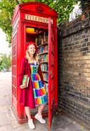 Vibrant Academia rainbow book dress in London phone box mini library
