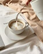 Milky coffee on a book