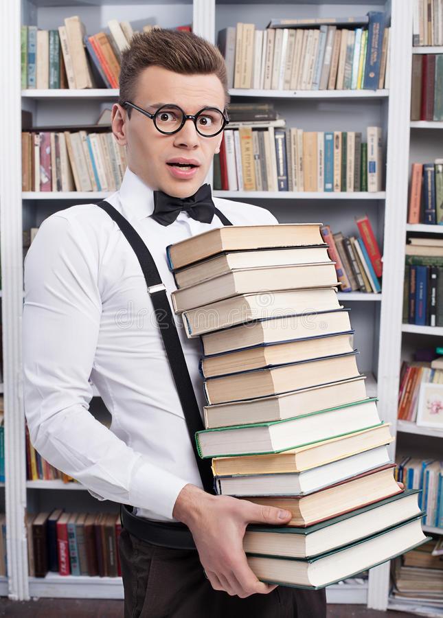 Nerd preparing to read tons of books (Nerd).jpg