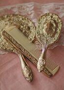 Gold hairbrush