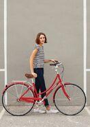 Striped shirt lady bicycle