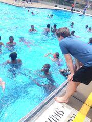 Nick-on-knees at poolside.JPG