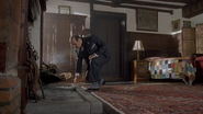 Hercule Poirot in Arden's room at the Stag