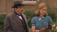 Lynn Marchmont and Poirot in the White House garden