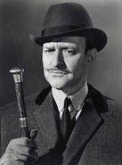 Randall as Poirot