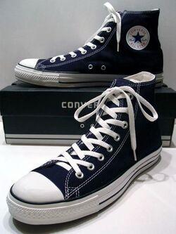 A classic Black pair of Converse All Stars resting on the Black & White Ed. Shoebox (1998-2002).JPG