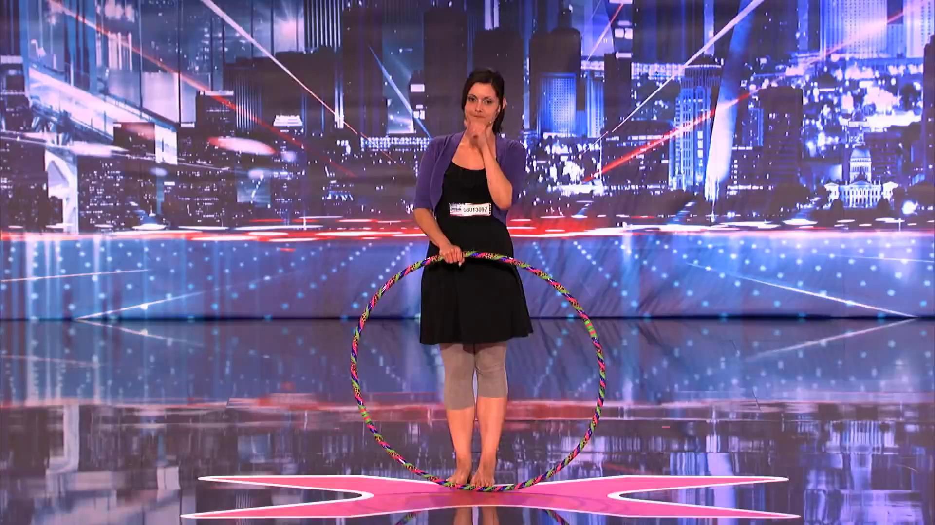 America's_Got_Talent_2013_-_Season_8_-_089_-_Lindsey_the_Hula_Belching_Girl_Burps_as_She_Hula_Hoops