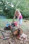 Splitting logs with a gas powered log splitter