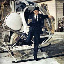 Frank Sinatra helicoper with drink.jpg