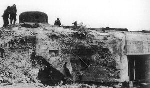 German soldiers inspects the cleared-out bunker OP-S 9 Na lukách near Opava.