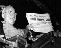 Truman holds errant newspaper