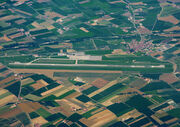 """An aerial photo of the only airport located in the Subalpine Federation, the """"Filippo I di Acaia"""" International Airport (formerly known as Cuneo-Levagildi)."""