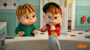 Alvin attempting to remove candy from Theodore's nostril