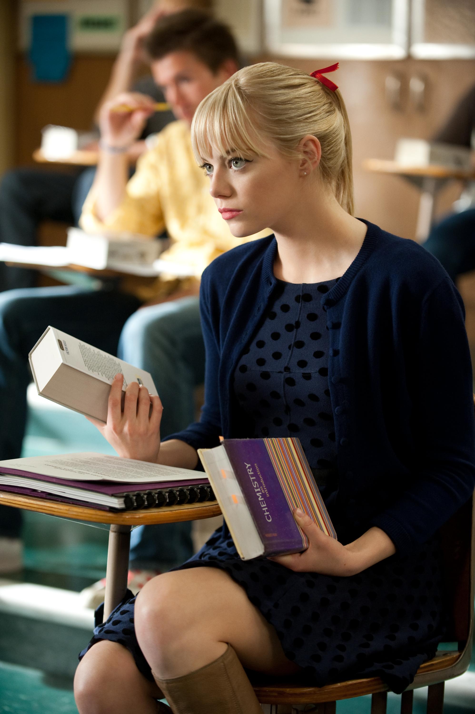 Gwen sits at her desk.jpg
