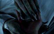 Norman's clawed hands TASM2