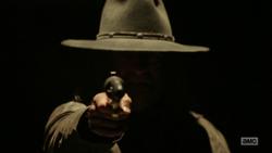 The Saint points his gun toward Jesse.png