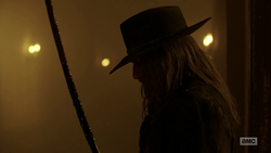 The Saint of Killers looks at his bloodied saber.png