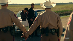 Jesse commands two state troopers to hold hands.png