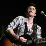 American-idol-winner-kris-allen-performs-during-the-2009-ame.jpg