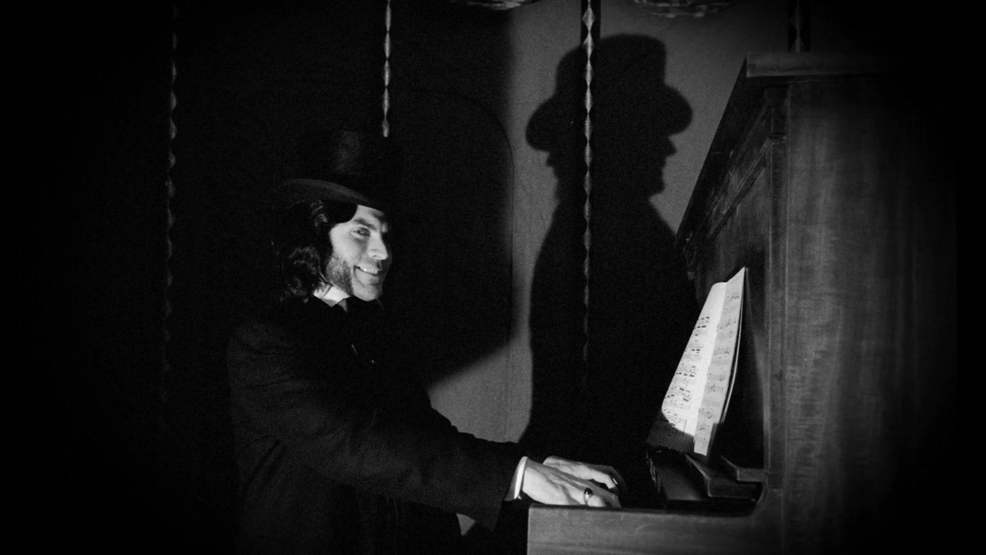 S04E03 Mordrake playing piano.jpg