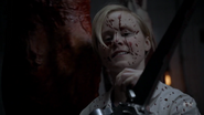 S7E07 Ivy with chainsaw