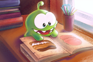 Om Nom Reading a Book on Candies