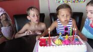 Amelia blowing out the candles