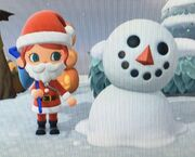 A cartoon snowperson having been slightly melted in Animal Crossing New Horizions, their round torso has begun to deteriorate and appear to be absorbed into the ground