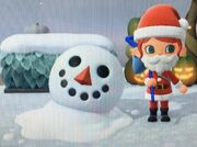 A screenshot from the video game Animal Crossing New Horizions, with a cartoon snowperson with barely any torso and only a head remaining