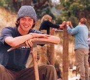 Conservation volunteer leaning on mattock1