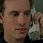 Tom on the phone.png