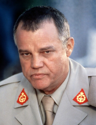 Joe Don Baker als Brad Whitaker, 1987