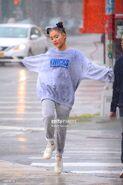Ariana and friends under the rain in NY September 18 (6)