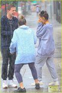 Ariana and friends under the rain in NY September 18 (4)