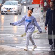 Ariana and friends under the rain in NY September 18 (5)