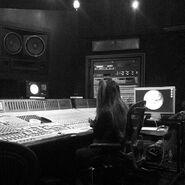 Ariana Editing Music in The studio