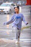 Ariana and friends under the rain in NY September 18 (8)