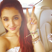 Ariana showing the peace sign.png
