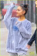 Ariana and friends under the rain in NY September 18 (3)