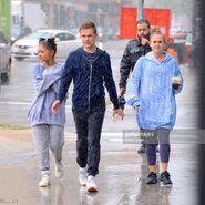 Ariana and friends under the rain in NY September 18 (7)