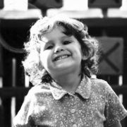 Little ariana smiling.png