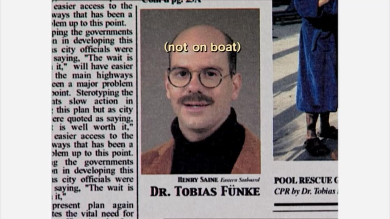 1x01 Tobias newspaper closeup.png