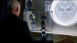 Damien Darhk with his trophies.png