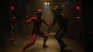 The Flash vs. Green Arrow in Arkham Asylum
