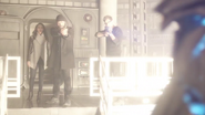 Harry and Joe defend Iris in Earth-2 from Savitar