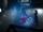 Mon-El and Kara look over the hologram recreation of Supergirl's battle.png