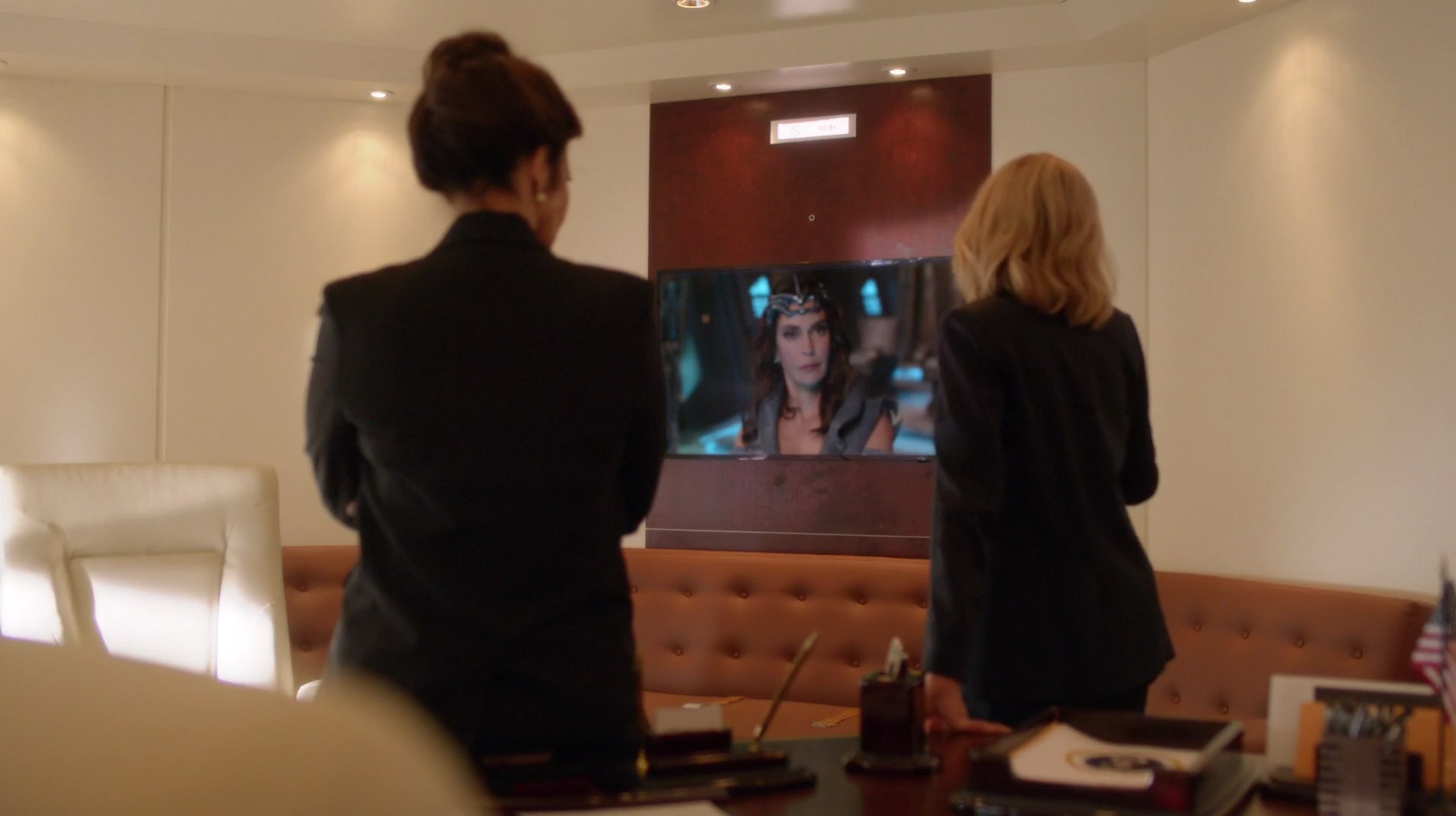 Cat Grant and President Marsdin speak with Rhea.png