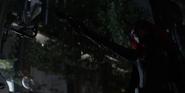 Ryan points a gun at a crows agent
