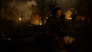 Oliver hovers over Thea's body on Lian Yu