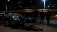The Flash, Firestorm, and The Arrow stand over a defeated Reverse-Flash